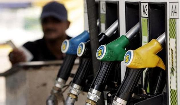A petrol pump attendant waits for customers at a station in New Delhi.(AFP Photo)