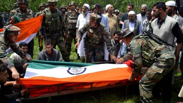 Army officers hold the funeral of 22-year-old Ummer Fayaz, who was abducted and killed by militants in Shopian district of south Kashmir on Tuesday night. (HT Photo)