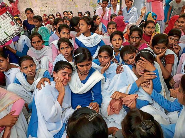 Girls sitting on hunger strike demanding upgrade of the village school in Rewari on Saturday.(HT Photo)
