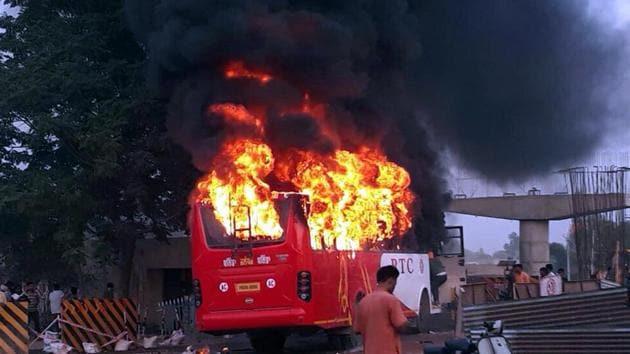 Bus on fire in Rampura Phul near Bathinda on Saturday.(Sanjeev Kumar/HT)