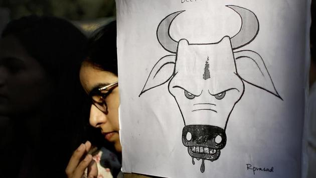 A student activist holds a placard during a protest denouncing cow vigilantism and killing of people in the name of cow protection in New Delhi.(AP FILE PHOTO/REPRESENTATIVE IMAGE)