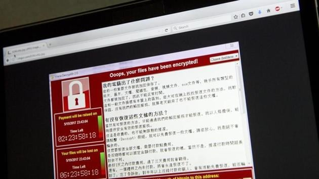 A screenshot of the warning screen from a purported ransomware attack, as captured by a computer user in Taiwan, is seen on laptop in Beijing.(AP)