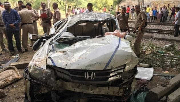 It took the police over 15 minutes to pull the students out as the car was completely damaged. The car skid off the flyover and fell off to land upside down on the ground.(HT Photo)