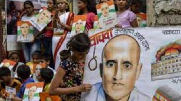 Students carry posters of Kulbhushan Yadav as they protest against his death sentence awarded by a Pakistani military court, in Mumbai, in April 2017.(Kunal Patil/HT File Photo)