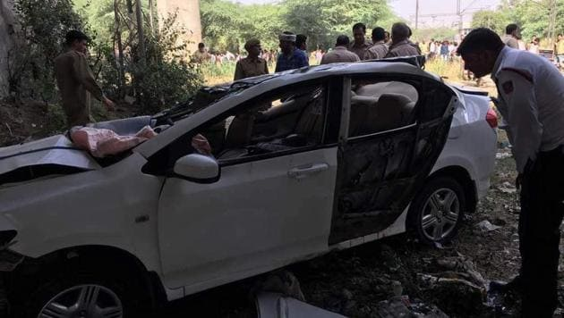 Seven students were driving down to their exam centre on Monday when their car met with an accident and fell off a flyover in Punjabi Bagh. Two students dies on the spot while two other succumber later. Three are still in ICU.(HT Photo)