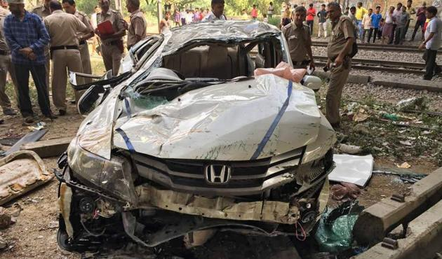 Three students were sitting in the front and four in the back seat of the Honda City car that toppled off a flyover in west Delhi's Punjabi Bagh on Monday.(Ravi Choudhary/HT Photo)