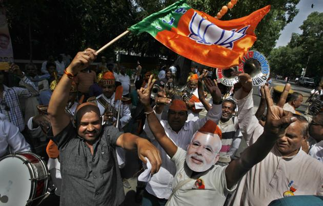 Bharatiya Janata Party workers celebrate after the party's victory in the 2014 Lok Sabha elections.(HT File Photo)