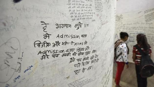 A wall in the Radha Krishna temple in Kota has prayers of students scribbled on them, in hopes that it will be answered. One recurring prayers is for an admission to the IIT, as seen in this photograph.(Raj K Raj/HT File Photo)
