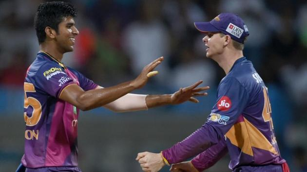Washington Sundar (L) celebrates with Rising Pune Supergiant skipper Steven Smith after the dismissal of Mumbai Indians batsman Ambati Rayudu during IPL 2017 first Qualifier in Mumbai on May 16. Washington Sundar, on Sunday, became the youngest player to appear in an IPL final.(AFP)