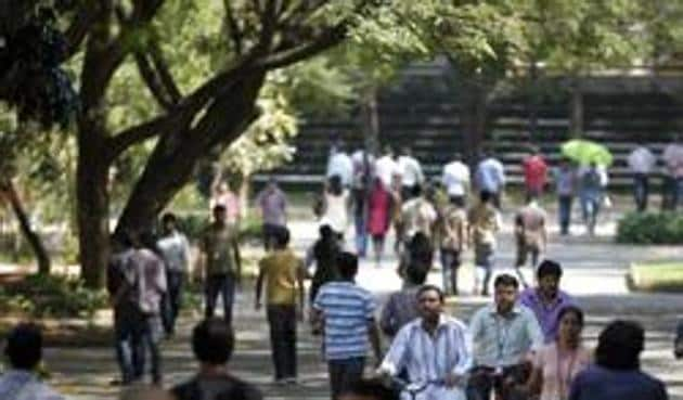 Infosys Technologies employees move through the headquarters during a break in Bangalore. Fears abound that thousands of techies are likely to lose their job, as automation and stricter job permits hit the Indian IT sector.(AP)