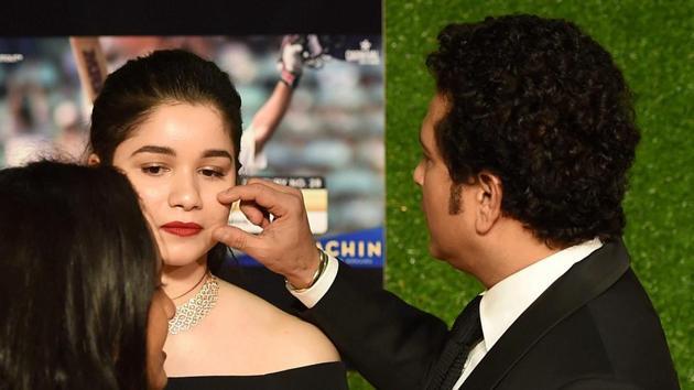 Sachin Tendulkar with his Daughter Sara Tendulkar during the premiere of his biopic Sachin: A Billion Dreams in Mumbai on Wednesday.(PTI)