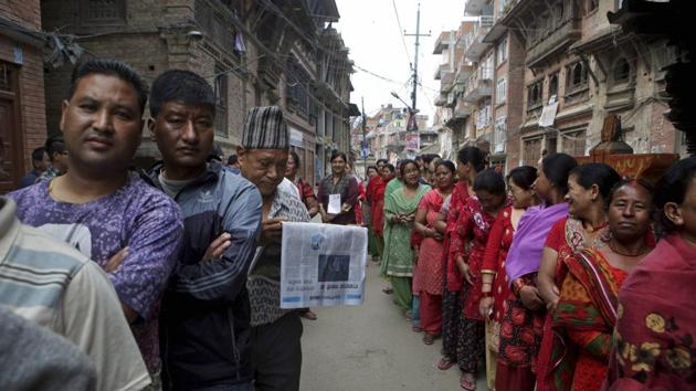 Nepalese stand in a queue to cast their votes at a polling station during the first phase of local elections in Bhaktapur on May 14.(AP File)