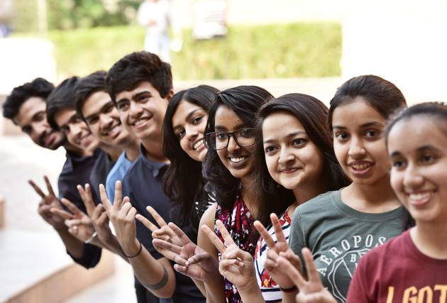 Students of Scottish High School, Sector-55, celebrate their ICSE results on Monday.(Sanjeev Verma/HT PHOTO)