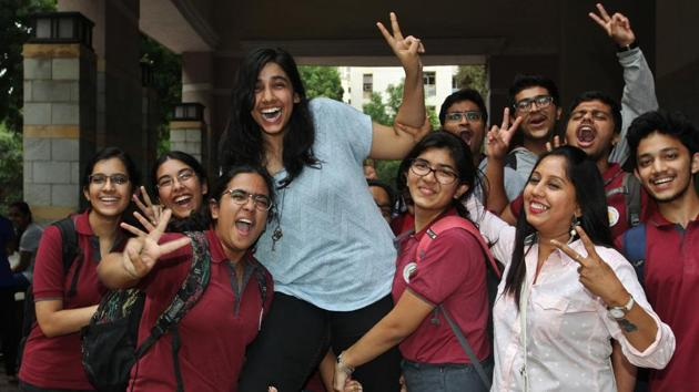Vaishnavi Dikshit (in blue) celebrates after scoring 97.8% in her ISC exams, at Thane on Monday.(Praful Gangurde)