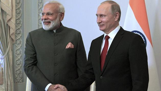 Russian President Vladimir Putin, right, shakes hands with India's Prime Minister Narendra Modi prior their talks at the St. Petersburg International Economic Forum in Russia on Thursday.(AP Photo)