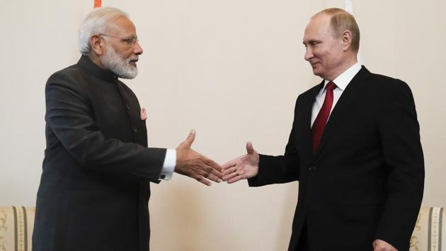 Indian Prime Minister Narendra Modi shakes hands with Russian President Vladimir Putin before their talks at the St Petersburg International Economic Forum in Russia.(AP Photo)