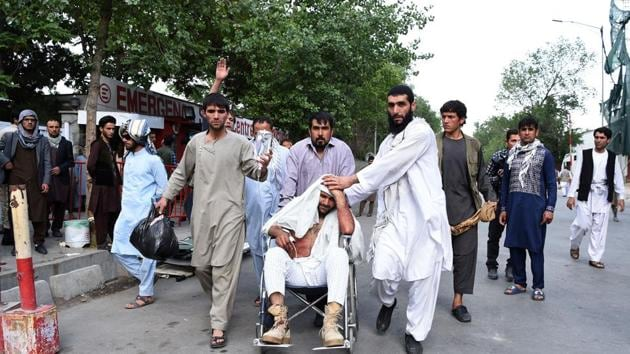 Afghan relatives push the wheelchair of a wounded man outside an Italian aid organization's hospital following a series of explosions that targeted a funeral of a politician's son, who was killed during an anti-government protest a day earlier, in Kabul on June 3, 2017.(AFP Photo)