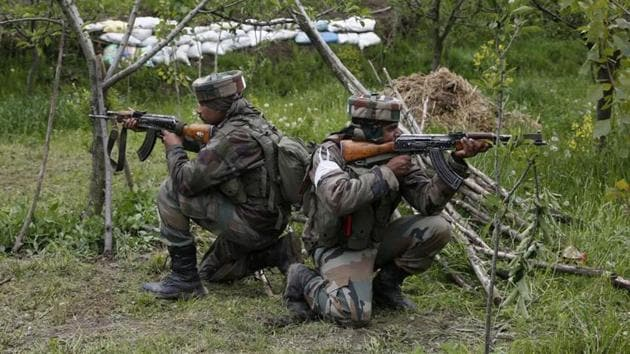 Army soldiers take position inside an apple orchard during a search operation in Kashmir. Men have traditionally dominated combat roles in the army, with only a handful of countries worldwide opening these positions to women.(AP File Photo)