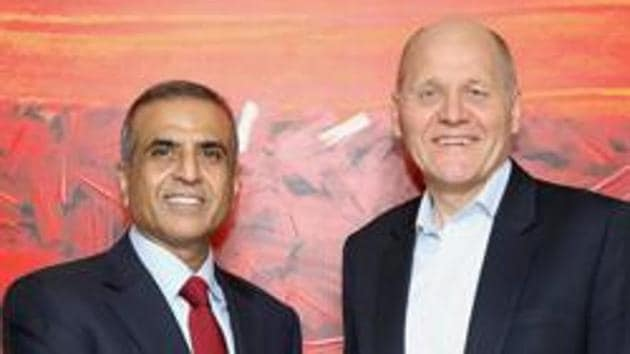 Sunil Bharti Mittal, founder and chairman of Bharti Enterprises shakes hands with Sigve Brekke, Telenor Group CEO after the announcement of Airtel's acquisition of Telenor (India) in February.(PTI file photo)