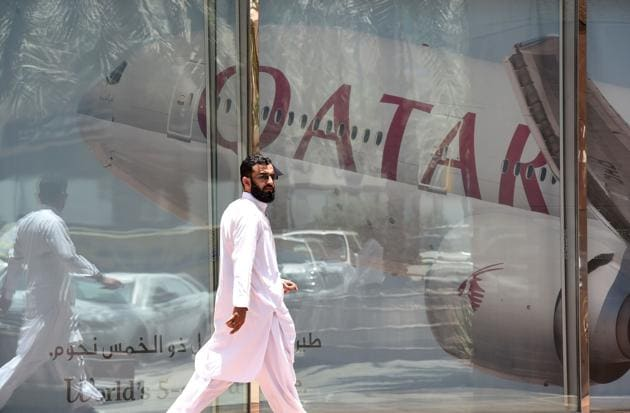 A man walks past the Qatar Airways branch in the Saudi capital Riyadh, after it had suspended all flights to Saudi Arabia following a severing of relations between major Gulf states and Qatar.(AFP Photo)