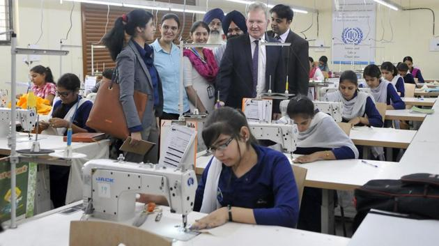 Officials interact with students and staff of the Multi Skill Development Centre in Ludhiana.(HT Photo)
