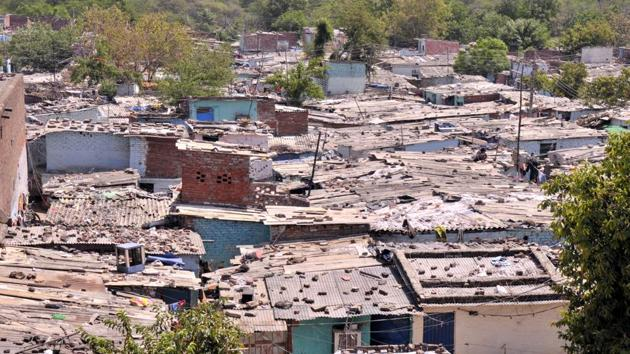 Colony No 4 in Industrial Area, Phase I, is the largest of the three remaining slums in the city that await rehabilitation.(HT Photo)