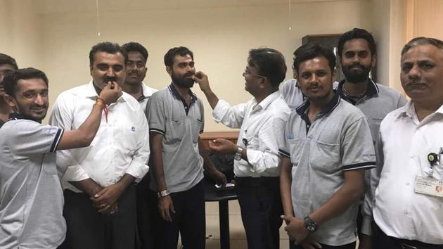 Tata Motors Worker Union members with Sanand plant head Neeraj Agarwal and HR head Vivek Bindra, at the signing of the LTS agreement for Sanand for a period of 5 years.
