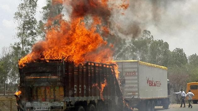 A truck burns during a farmers protest on a highway near Madhya Pradesh's capital Bhopal on June 9.(REUTERS Photo)