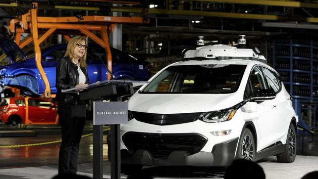 General Motors chairman and CEO Mary Barra updates the media on the company's autonomous vehicle development program at GM's Orion Assembly in Lake Orion, Michigan on Tuesday. Barra stands next to a self-driving Chevrolet Bolt EV, one of 130 the company has built at a factory in suburban Detroit, making it among the first automakers to mass produce self-driving vehicles.