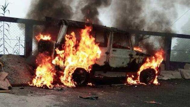 A car at Bimal Gurung's house set on fire on Thursday.(HT Photo)