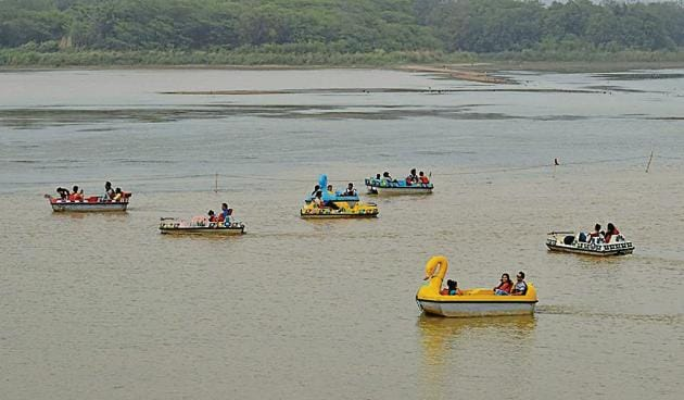Boating on at the lake on Saturday, even as red flags mark the restricted area.(Sikander Singh/HT)