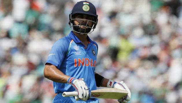 India's Virat Kohli leaves the pitch after being dismissed for five runs during the ICC Champions Trophy final against Pakistan.(AP)