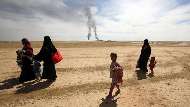 Displaced Iraqi families evacuate from the modern town of Hatra and neighbouring villages, near the eponymous UNESCO-listed ancient city, southwest of the northern city of Mosul, on April 26, 2017, as pro-government Hashed al-Shaabi (Popular Mobilisation) paramilitary forces advance during an offensive to retake the area from Islamic State (IS) group fighters. Hatra is the latest important archaeological site to be recaptured from IS. Jihadists had embarked on a campaign of destruction against archaeological sites after they seized swathes of Iraq and Syria in a lightning 2014 offensive. The full extent of the harm to Hatra remains unclear. (AFP)