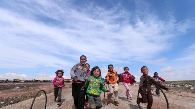 Internally displaced children who fled Raqqa city play in a camp in Ain Issa, Raqqa Governorate, Syria. (REUTERS)