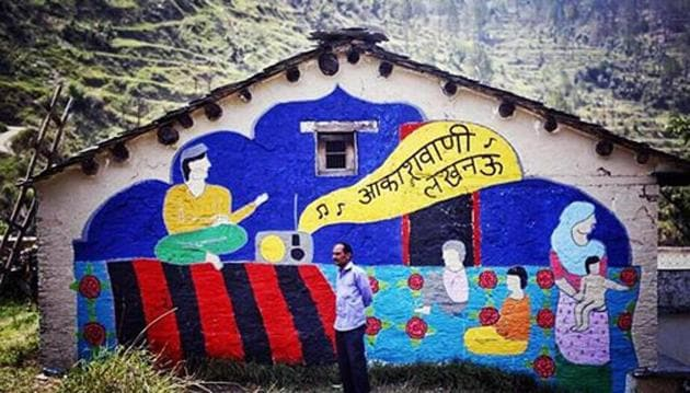 One of the art works on the wall of an abandoned house in Saur village in Tehri.(HT Photo)
