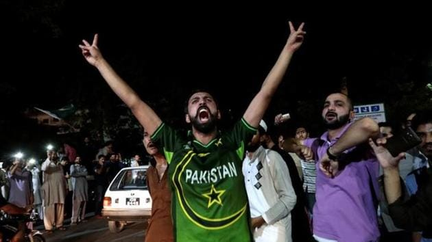 Pakistani cricket fans cheer after Pakistan defeated India in the ICC Champions Trophy final.(Reuters)