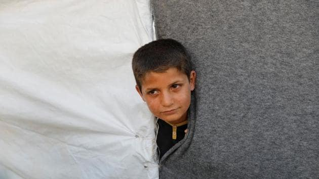 An evacuee looks out from a tent inside a refugee camp for people who fled from Mosul due to fighting between Iraqi forces and Islamic State militants, on the outskirts of Erbil, Iraq June 10, 2017. (REUTERS)