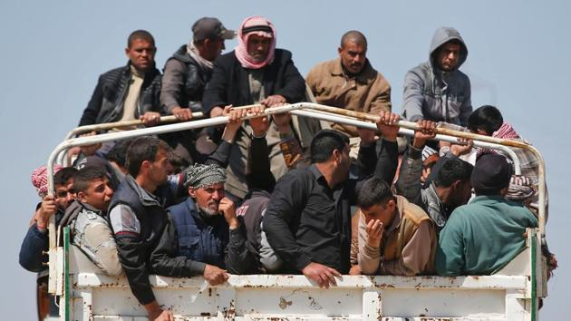Displaced Iraqis, who fled their homes in the Old City in western Mosul due to the ongoing fighting between government forces and Islamic State (IS) group fighters, are taken to the Hammam al-Alil camp, south of Mosul, on March 27, 2017. Iraqi forces renewed their assault against jihadists in Mosul's Old City, after days in which the battle was overshadowed by reports of heavy civilian casualties from air strikes. (AFP)