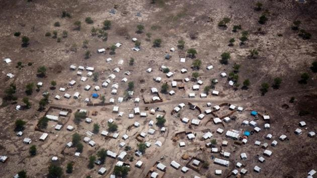 Aerial view of the new settlement of displaced families in Aburoc, South Sudan on June 5, 2017. Government offensives on the West Bank of the Nile river in April and May 2017 led to the capture of several villages, including Kodok. Up to 25,000 people were displaced during these clashes, most of whom initially fled toward Aburoc. In subsequent weeks, at least 20,000 people fled to Sudan. Many of those in Aburoc walked for days on foot to reach the location without access to sufficient water due to conflict along the River Nile and arrived exhausted and weak. (AFP)