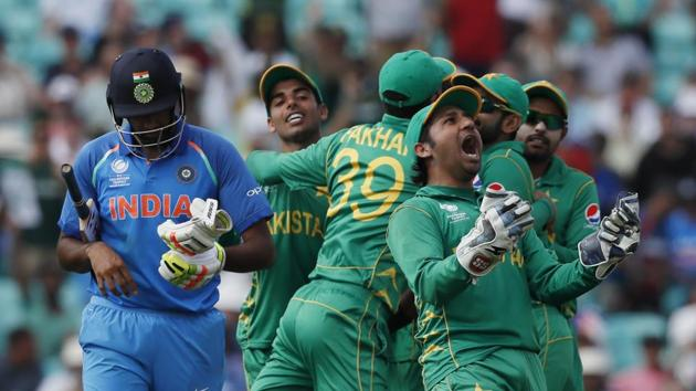 Pakistan's captain Sarfraz Ahmed, right, celebrates the dismissal of India's Ravichandran Ashwin, left, during the ICC Champions Trophy final at The Oval in London, Sunday, June 18, 2017.(AP Photo)