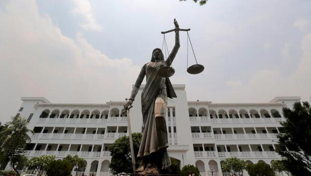 The statue of Lady Justice stands after it was reinstalled near the Supreme Court complex in Dhaka, Bangladesh, May 28(AP)