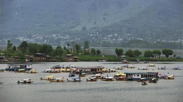 Boatmen row their boats during a shikara festival at Dal Lake in Srinagar organised by the Jammu and Kashmir government to promote tourism.(PTI File Photo)