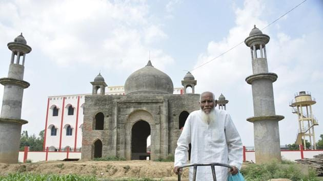 Faizul Hasan Qadri, 81, stands next to his 'Taj Mahal'. The school built on the land donated by him see in the background.(Sakib Ali / HT Photo)