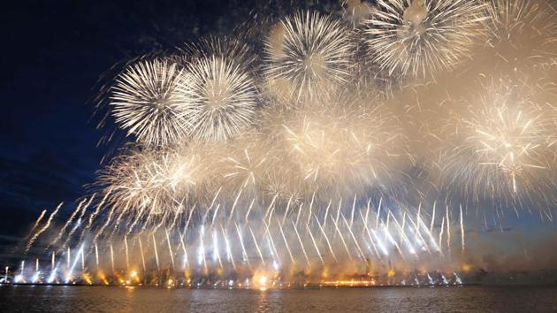 <p>Fireworks explode over the Neva River during the Scarlet Sails festivities in St. Petersburg, Russia. The Scarlet Sails is an annual citywide celebration in...