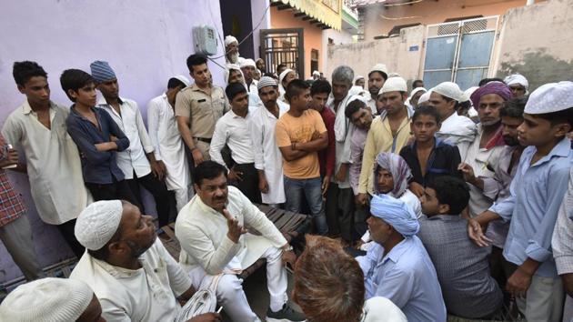 Local residents gather outside the residence of Hafiz Junaid in Faridabad on Friday.(Ravi Choudhary/HT PHOTO)