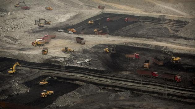 Vehicles work at an open-pit coal mine near Ordos in northern China's Inner Mongolia Autonomous Region.(AP File Photo)
