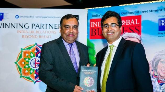 Indian high commissioner YK Sinha releasing the book Winning Partnership edited by Manoj Ladwa (right) in London on June 26, 2017.(HT Photo)