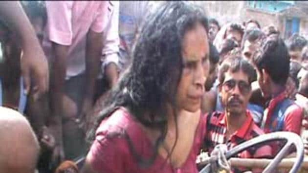 A video grab of 42-year-old Otera Bibi being manhandled by villagers before her death.(HT Photo)