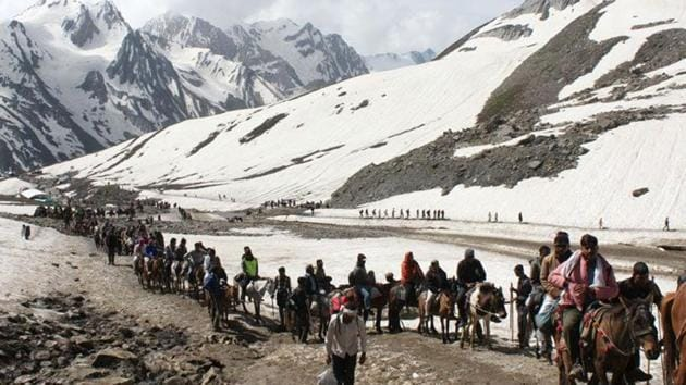 Pilgrims on way to Amarnath Yatra on their mules.(HT File)