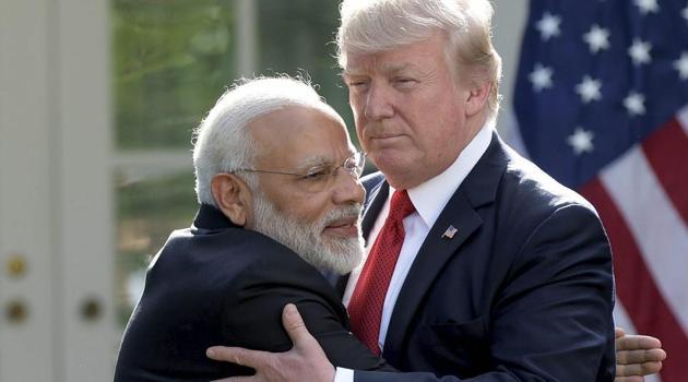 US President Donald Trump and Indian Prime Minister Narendra Modi hug at the White House in Washington on Monday.(AP photo)